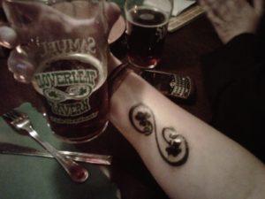 tattoo of pub logo